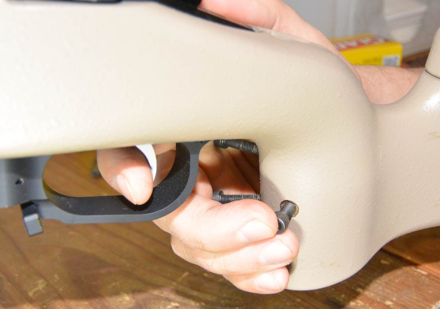 Screws in place outlining where the molded grip will eventually be