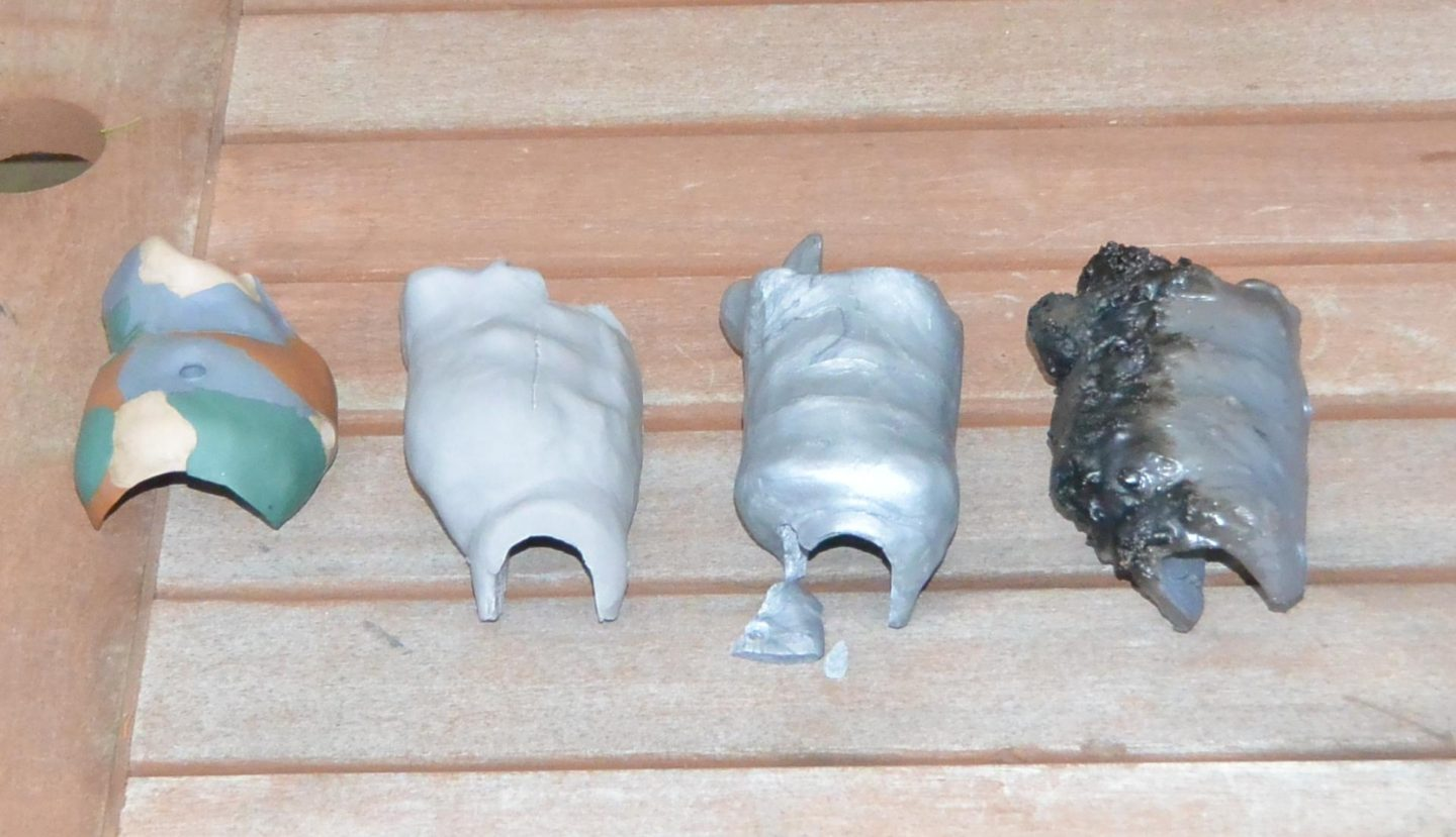 So many failures: Left to right, Premo camo grip with surface cracks, Super Sculpey cracked grip, Kato crumbly POS, and Premo grip my oven incinerated