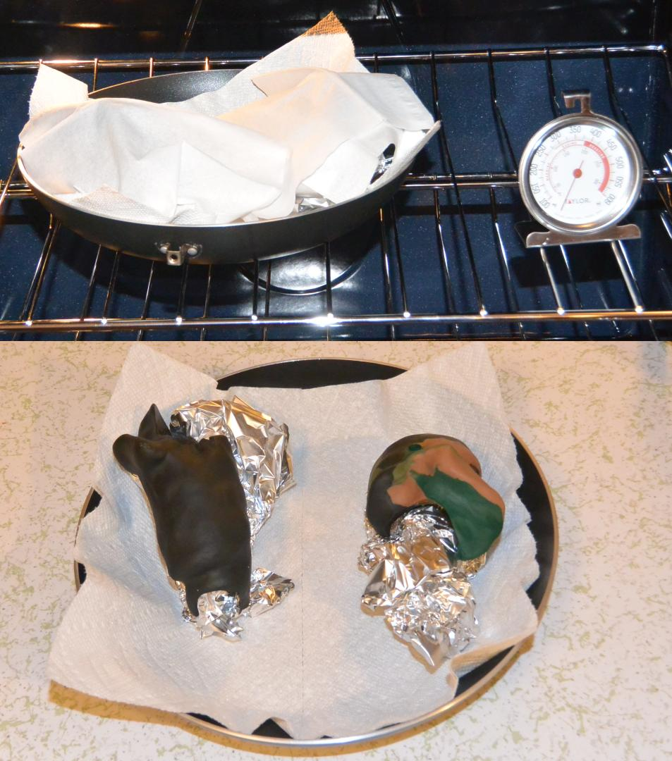 A couple of grips covered up in the oven after firing and uncovered sitting on their tin foil supports
