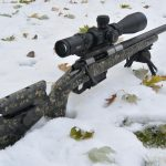 Proof Barreled Mesa Precision Arms Rifle in the snow.