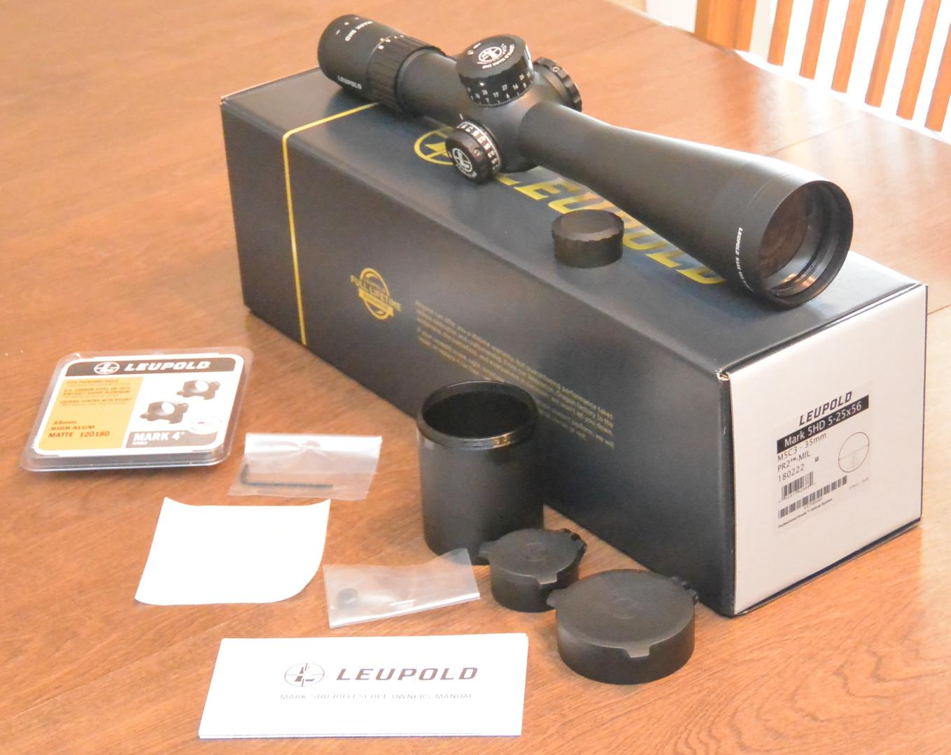 Leupold Mark 5HD 5-25x56 Unboxing showing included sunshade and flip caps (rings are not included)