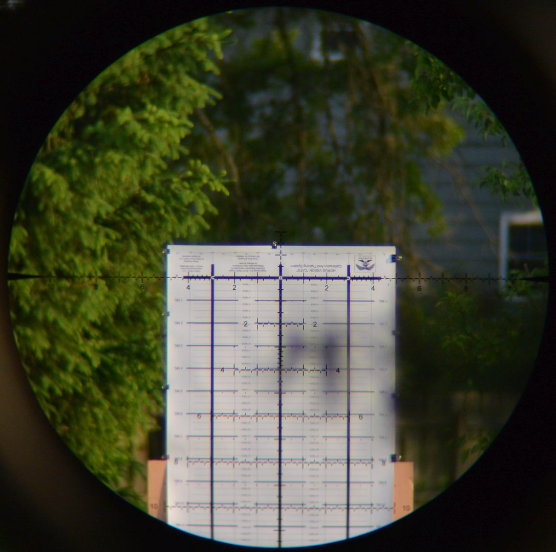 Horus CATS test target though the Leupold Mark 5HD 5-25x56 scope with annoying tree branch in foreground