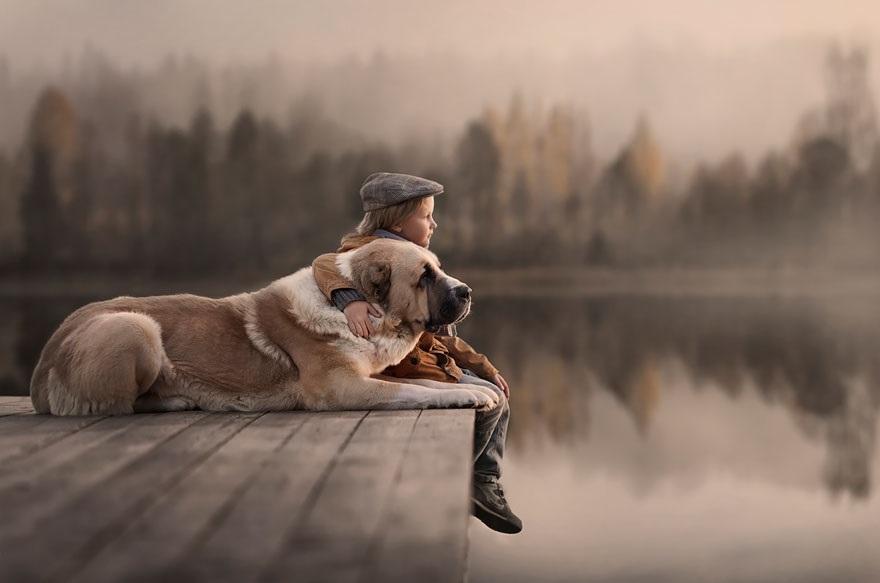 boy dog lake.jpeg